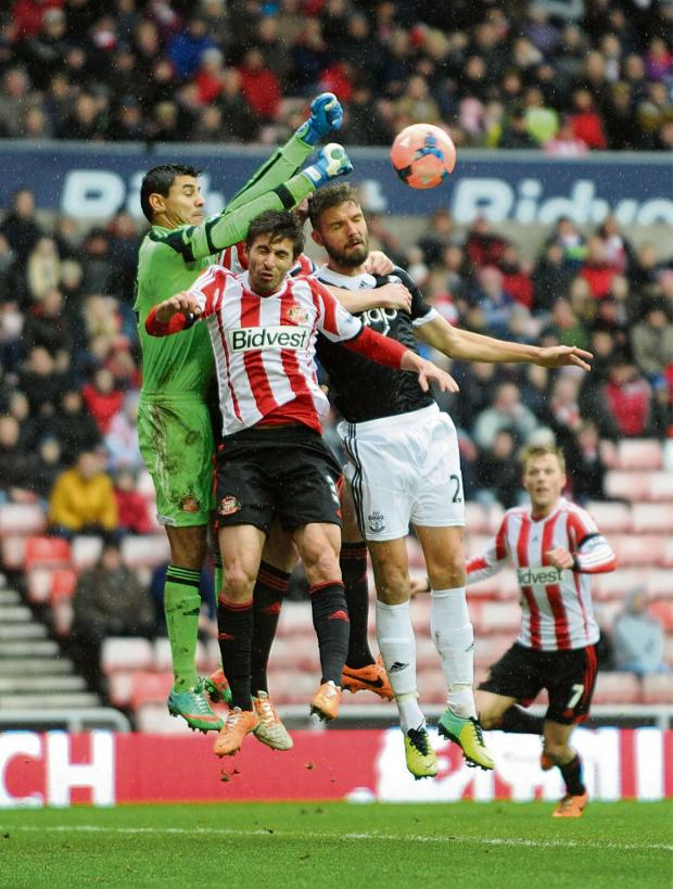 The Advertiser Series: GONE: Goalkeeper Oscar Ustari, on one of his rare appearances for Sunderland, jumps with Fabio Borini against Southampton