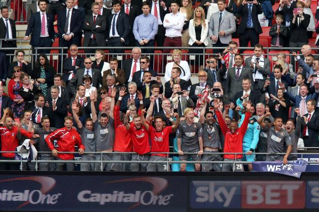 The Advertiser Series: Promotion party: Middlesbrough's Richie Smallwood, third from left, celebrates at Wembley after Rotherham United's League One play-off final success on Sunday