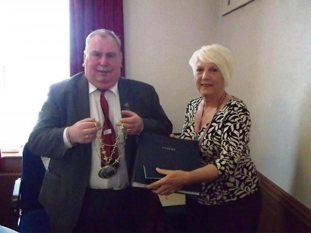 The Advertiser Series: CHAINS CHANGE HANDS: Coun Ken Campbell hands Ferryhill mayoral chains to Coun Pauline Crathorne