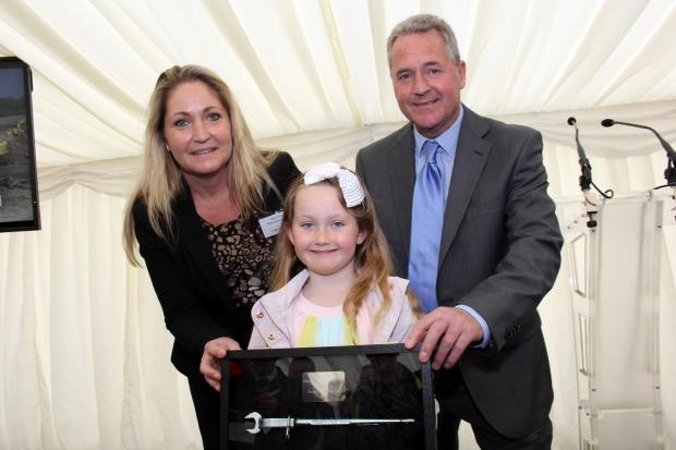The Advertiser Series: Julie, Grace and John Finley with the framed podger presented by Hitachi to mark the steelwork contract