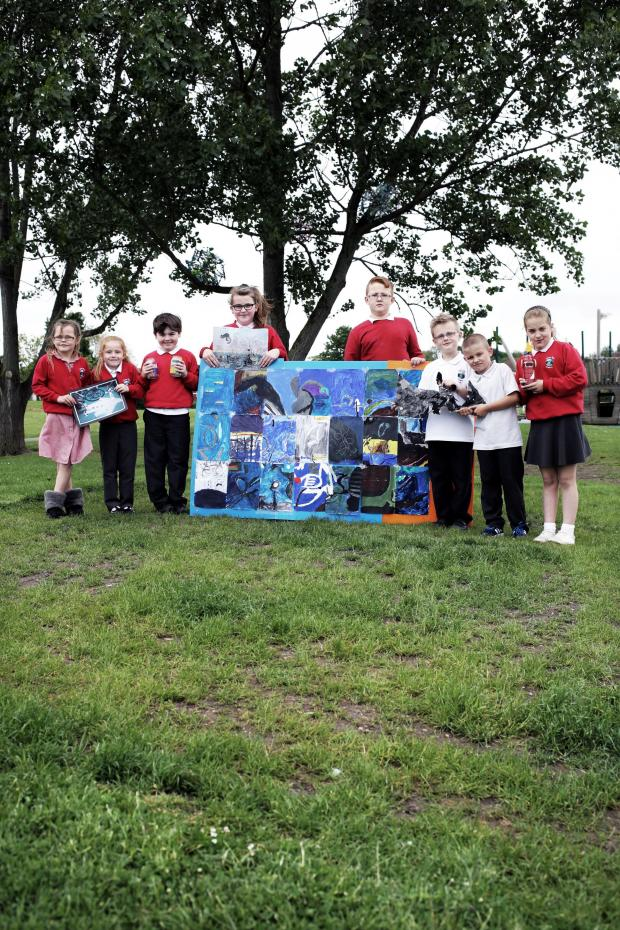 The Advertiser Series: YOUNG ARTISTS: Pupils at Skerne Park Acadamy with their art work. PICTURE: Stuart Boulton. (6510298)