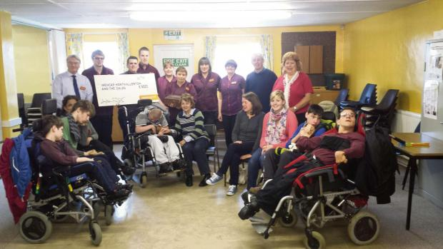 The Advertiser Series: CHARITY PARTNERS: Sainsbury's staff present their cheque to Mencap in Northallerton.
