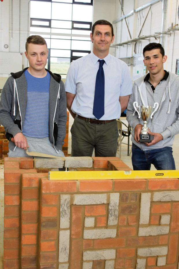The Advertiser Series: BRICKLAYING SUCCESS: Nathan Cooper, left,  and David Wood with their lecturer at Bishop Auckland College Chris Le