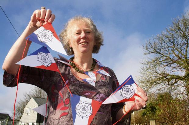 The Advertiser Series: TOUR-INSPIRED: Carol Watson with some of her bunting mixing the French tricolour with the Yorkshire rose.