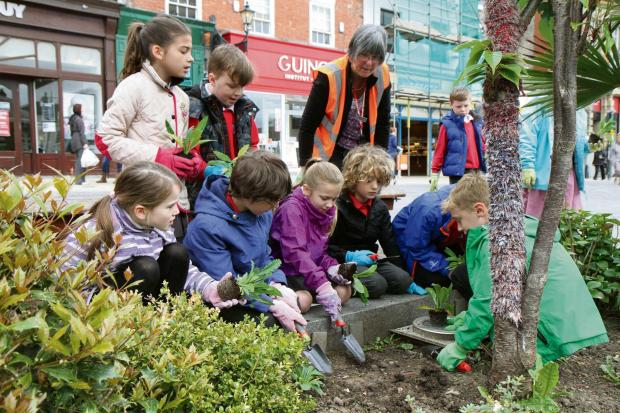 The Advertiser Series: POPPY PLANTING: Pupils from the Federation of Abbey Schools plant poppy plants on Darlington's High Row     Picture: RICHARD DOUGHTY