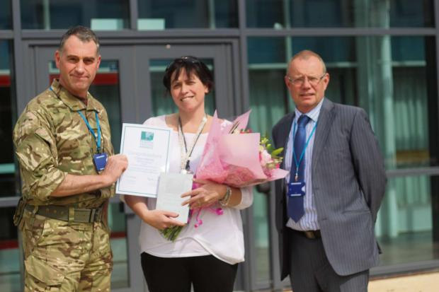 The Advertiser Series: Top teacher:Carys is presented with her award by Col Stephen Padgett and Headteacher Ian Ro