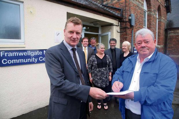 The Advertiser Series: Gordon Elliott from Durham County Council, left, and Chairman of Framwellgate Community Association Colin Hillary, right, sign an agreement to take over the running of the Community Centre. Background from left are councillor Mark Wilkes, Ross Cowling fro
