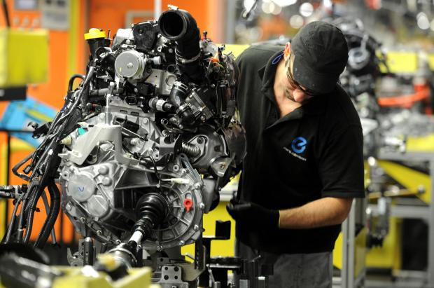 The Advertiser Series: SALES RISE: A Nissan employee works on components for a Qashqai model