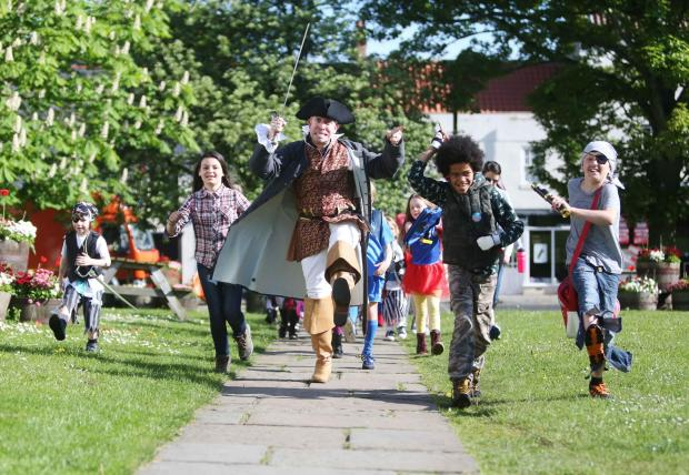 The Advertiser Series: THEMED WALK: Pirate Dave Elliot Cooper from Histrionics drama company with Harry Gething, six, Elise Cabanes-Bouveng, 11, Joshua Delapanosta and Daniel Turnbull, both ten