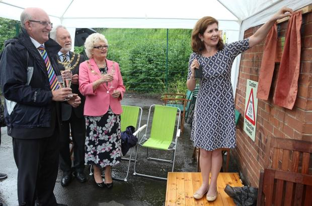 The Advertiser Series: SUCH A BUZZ: Darlington MP Jenny Chapman unveils a commemorative plaque at the official opening of the new community apiary in the Denes    Picture: CHRIS BOOTH