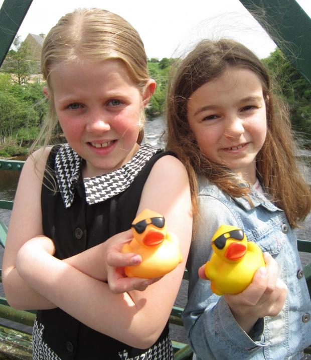 The Advertiser Series: Youngsters Amy Hughes and Isobel Yeadon with the ducks they were unable to race in the River Tees