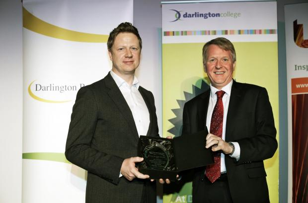 The Advertiser Series: BUSINESS SUCCESS: Jake Tompkins, left, Modus Seabed Intervention's managing director, pictured receiving a Best of Darlington Award from David Dodd