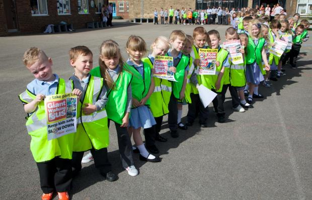 The Advertiser Series: ROAD SAFETY: Pupils took part in a countrywide giant walking bus initiative. PICTURE Keith Taylor