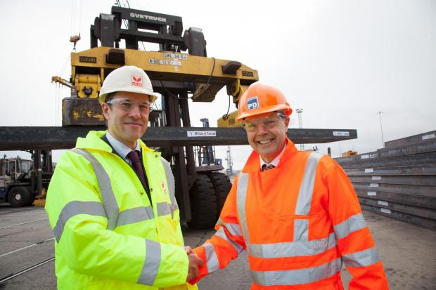 The Advertiser Series: NEW DELIVERY: Cornelius Louwrens, SSI UK business director and chief operating officer, with PD Ports' Jerry Hopkinson as steel slab is exported through Teesport