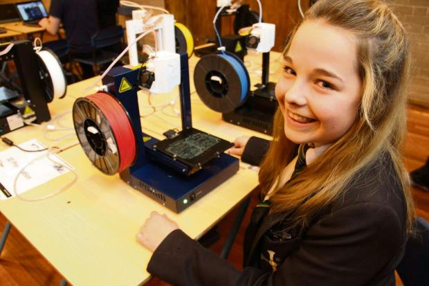 The Advertiser Series: YOUNG INVENTOR: Lauren Austin, 13, checks out a 3D printer.