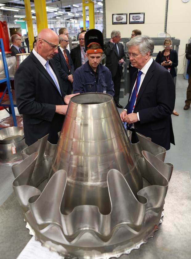 The Advertiser Series: FACTORY EXPANSION: Billy Meijer, Darchem managing director, left, talks to apprentice James Kenny and Energy Minister Michael Fallon about an Aro engine mixer