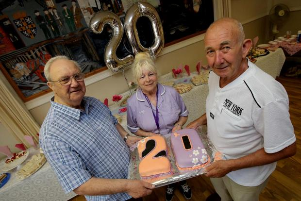 The Advertiser Series: SPECIAL DAY: Long standing volunteer driver Mike Pennack, left, home care assistant Anne Foster and management committee member Brian Meek celebrate a charity's 20th anniversary