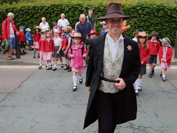 The Advertiser Series: COWBOY WALK: David Cooper from Histrionics leads children to Abbey Road Infants School, Darlington.        Picture: ANDY LAMB