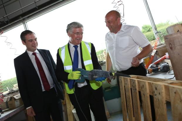 The Advertiser Series: SITE VISIT: Business Minister Michael Fallon, centre, with James Wharton, Stockton South MP, left, and Owen Hines, Returnable Packaging Services' general manager
