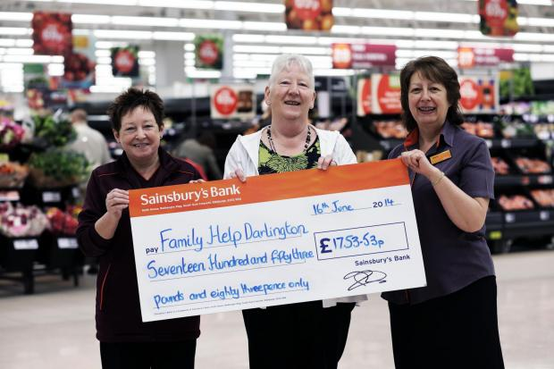 The Advertiser Series: FUND RAISERS: Marilyn Whyte and Marie Steward of Sainsbury's in Darlington present a cheque to Susan Degnan of Family Help Darlington CIO. PICTURE: Stuart Boulton