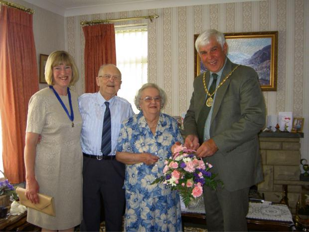 The Advertiser Series: HAPPY ANNIVERSARY: Mr and Mrs Ferry are presented with a bouquet by Hambleton  District Council's vice-chairman Stephen Dickins and his wife Margaret.