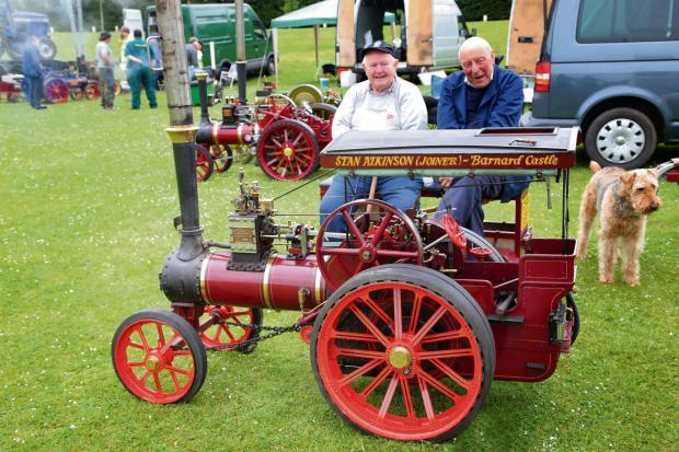 The Advertiser Series: VINTAGE VEHICLES: Stan Atkinson, right, with his traction engine watched by Bill Butterfield.