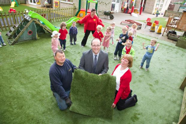 The Advertiser Series: GARDEN RESTORED: From left, David Bell, of DJ Garden Landscapes, with Nick Bisicker, sales manager at Grass Direct and Linda Watts, manager of Playday Nursery.