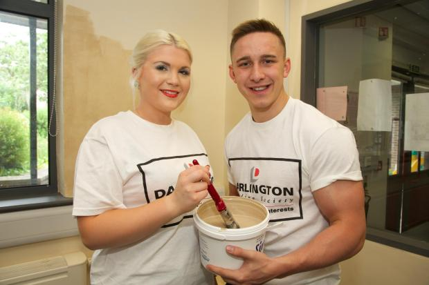 The Advertiser Series: LEND A HAND: Josh Palin and Ellie Durham of Darlington Building Society volunteer to decorate the Red Hall Community Centre   Picture: Keith Taylor