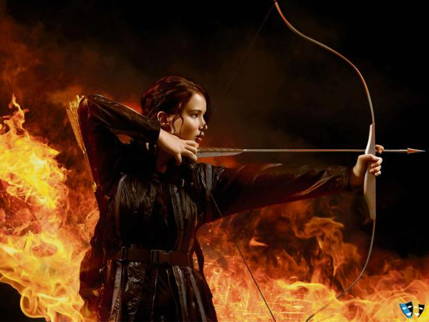 The Advertiser Series: GOOD SHOT: Jennifer Lawrence takes aim in The Hunger Games: Catching Fire