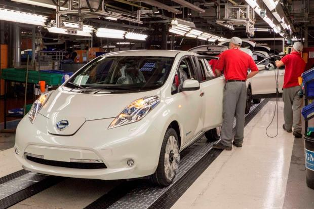 The Advertiser Series: NEW MODEL: Workers build a Nissan Leaf at the company's Sunderland plant