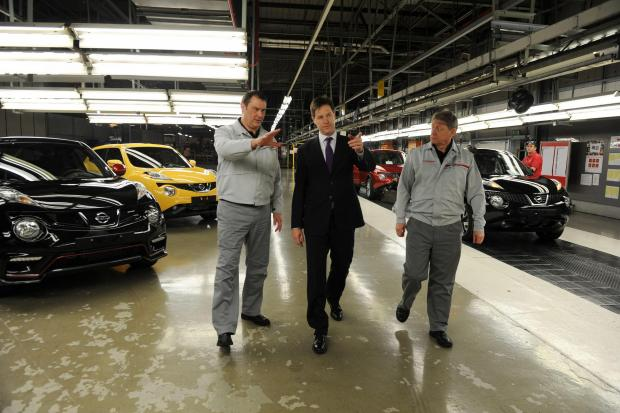 The Advertiser Series: Deputy Prime Minister Nick Clegg with vice president Kevin Fitzpatrick (right) and prodution manager Andy Drake (left) during a visit to the Nissan Plant in Sunderland.  (7319412)