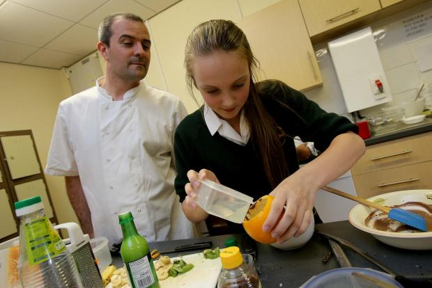 The Advertiser Series: READY STEADY COOK: Student Megan Gibson (13) from Durham High School for Girls takes part in the cooking competition watched by judge Andrew Cassin, Executive Chef at the Ramside Hotel. Picture: DAVID WOOD (7341573)