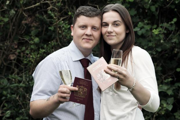 The Advertiser Series: HUGE RELIEF: Daniel and Jessica Riley celebrate with their passports PICTURE: STUART BOULTON