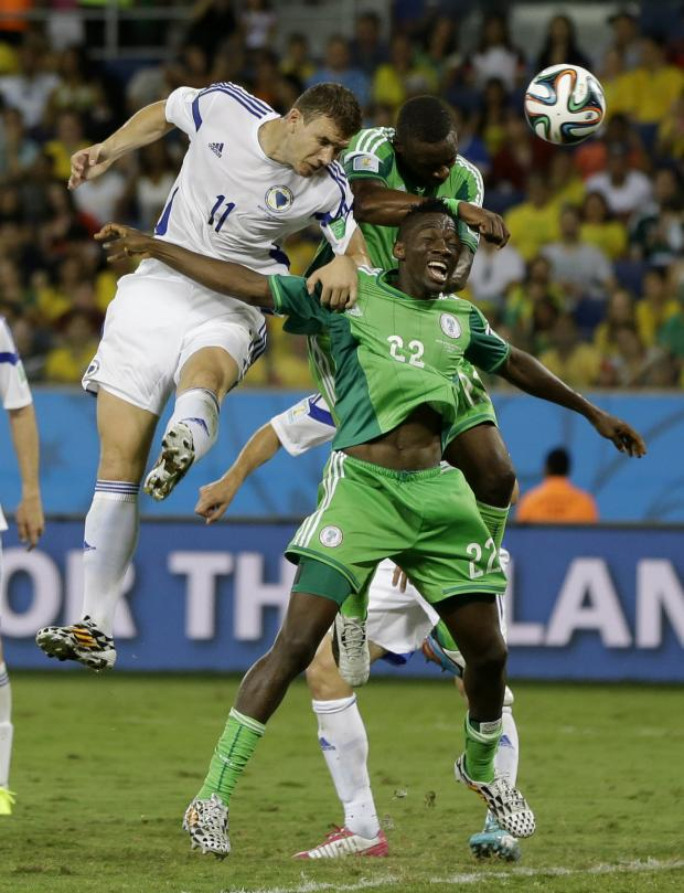 The Advertiser Series: CHALLENGING HARD: Kenneth Omeruo (number 22) challenges Edin Dzeko for a header during Nigeria's 1-0 win over Bosnia on Saturday night
