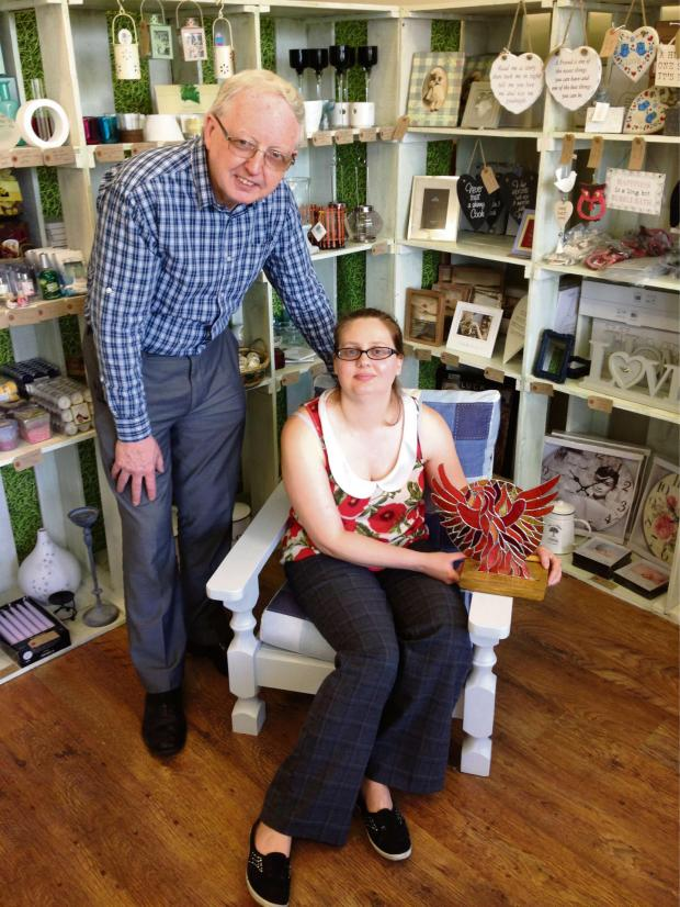 The Advertiser Series: PAST POSTIE: Martin Connolly and his daughter Angela Newton, who is holding one of her stained glass sculptures, in their new venture, the Artview Studio