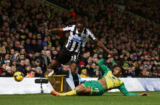 The Advertiser Series: LENDER FINE: Wonga has been ordered to pay £2.6m compensation. The firm sponsors Newcastle United's shirts, shown here last season as Shola Ameobi battles with Norwich City's Leroy Fer