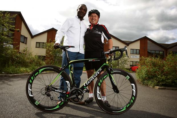 The Advertiser Series: CHARITY RIDE: Sixty-two-year-old businessman Billy Morgan, pictured with church pastor DIdi Dolopei, is preparing for a 100-mile cycle ride in aid of his church&am