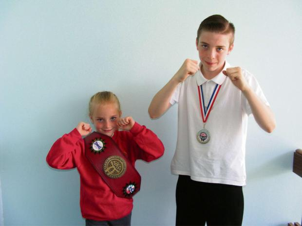 The Advertiser Series: THAI BOXERS : Aidan Forster and his sister, Amy Forster, celebrate success at a Thai boxing championship.