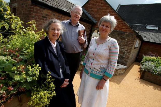 The Advertiser Series: GARDEN OPENING: Sister Lucy Sacco (left) joins Father Gordon Ryan and Kathryn Turner (right) during the event at St Cuthbert's Community Centre in Crook. Picture: DAVID WOOD
