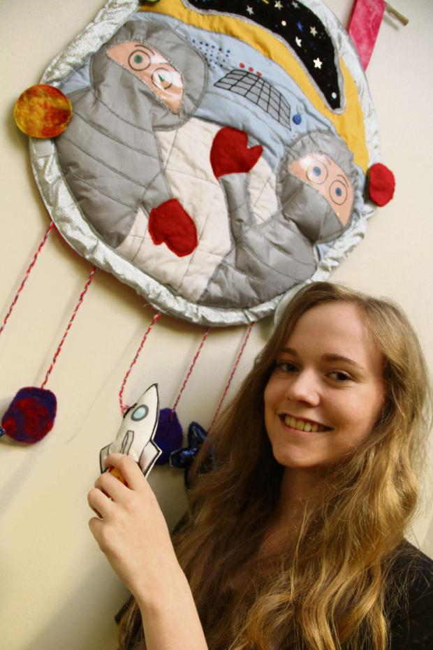 The Advertiser Series: SPACE ART: Emily Renwick, 16, with her space travel interactive wall hanging