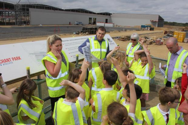 The Advertiser Series: SCHOOL VISIT: Julie Finley, managing director of Finley Structures,  pictured with schoolchildren during the visit to Hitachi's £82m new train factory
