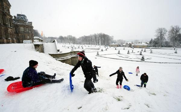 The Advertiser Series: WINTER WONDERLAND: Youngsters enjoy sledging at Bowes Museum in Barnard Castle, County Durham. M and S Plastics, in Spennymoor, is known for its production of sledges