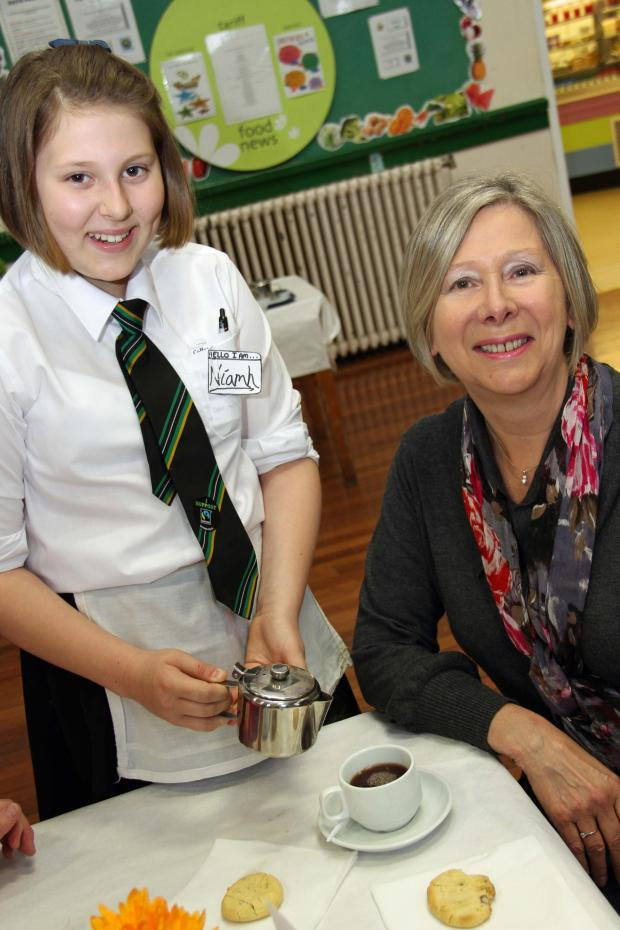 The Advertiser Series: COFFEE TIME: Niamh Wheldon, 12, serves her grandmother Jennifer D
