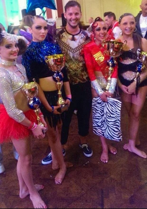The Advertiser Series: STEPPING UP: Dance school owner, Darrien Wright, with his winning performers