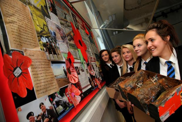 The Advertiser Series: CHARITY TEAM: Organisers of a Mexican-themed fundraiser for the British Legion at the Education Centre in Darlington. From left fifteen year olds with their WW1 display and holding their models of the trenches a