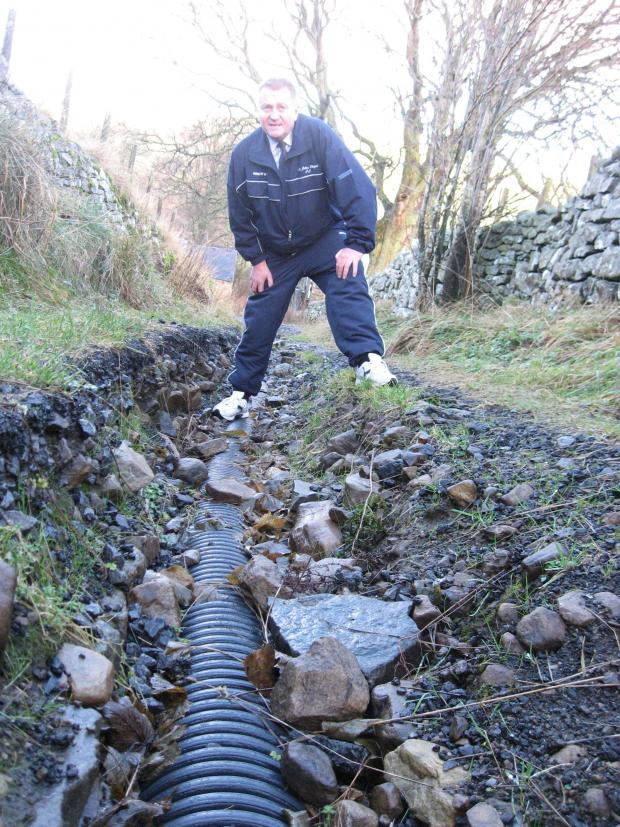 The Advertiser Series: WASHED AWAY: Weardale County Councillor John Shuttleworth is calling for the Lonen to be fixed