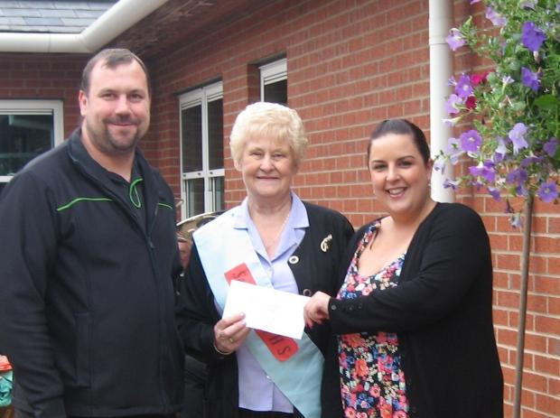 The Advertiser Series: RAFFLE DONATION: Organiser Julie Welford  (centre) with Co-op managers Stephen Mould and Hayley Gibson