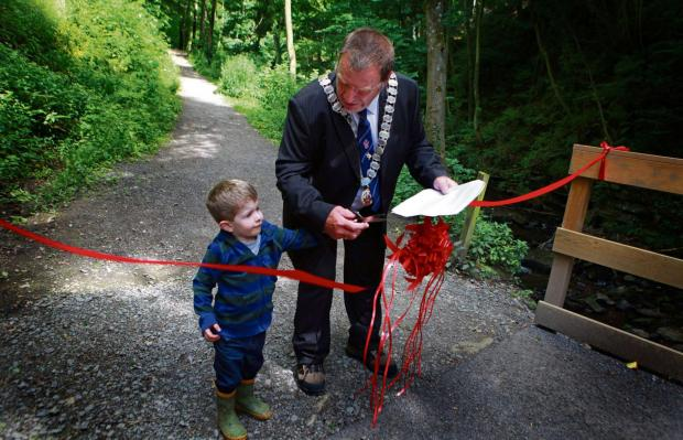 The Advertiser Series: FLATTS WOOD: Barnard Castle Mayor John Blissett with grandson Isaac John Blissett, aged two, performs the ribbon cutting to mark the completion of improvements to Flatts Wood Picture: SARAH CALDECOTT