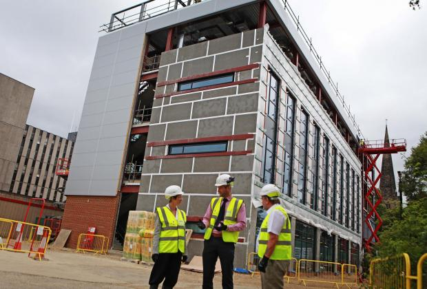 The Advertiser Series: BUILDING SITE: The Department for Education building, in Darlington. Pictured are Darlington Borough Council chief executive, Ada Burns, with council leader, Bill Dixon, right, and Sean McNicholas, the project's senior building manager. Picture: SARAH