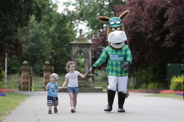 The Advertiser Series: CHARITY TODDLE: 1 year old Toby Sherwood-Parkin and 4 year old Esme Smith with the Macmillan horse in Darlington's South Park. (8023491)